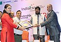 The Minister of State for Social Justice & Empowerment, Shri Ramdas Athawale presenting the India CSR Leadership award to the Nanda Ghar project of Vedanta Limited, at the India CSR Leadership Summit, in Mumbai.jpg