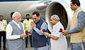 The Prime Minister, Shri Narendra Modi being welcomed by the Chief Minister of Gujarat, Shri Vijay Rupani and the Deputy Chief Minister of Gujarat, Shri Nitinbhai Patel, on his arrival, at Surat, in Gujarat.jpg