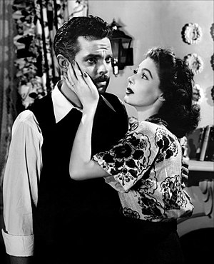 English: Orson Welles & Loretta Young in The S...
