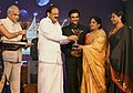 The Vice President, Shri M. Venkaiah Naidu giving away Magudam Awards constituted by News18 Tamil Nadu, for the best and the brightest from Tamil Nadu in various fields, in Chennai.jpg