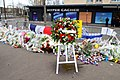 The Wreath Laid by Secretary Kerry and French Foreign Minister Fabius Is Pictured Outside the Hyper Cacher Kosher Market in Paris (16106400057).jpg