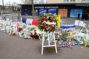 January 2015 Île-de-France attacks - Memorials for the victims of the Charlie Hebdo shooting (above) and Hypercacher Kosher Supermarket siege (below)