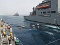 The afloat forward staging base USS Ponce (AFSB(I) 15), left, prepares to receive fuel from the dry cargo ship USNS Medgar Evers (T-AKE 13), right, as the amphibious dock landing ship USS Carter Hall (LSD 50) 130516-N-ZZ999-020.jpg