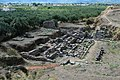 The ancient theatre of Sparta, set against a hill and a large olive grove.jpg