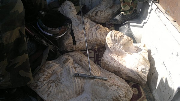 The damage of artefacts due to illicit trade at Palmyra, Syria.jpg