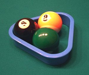 Three-ball - Using the 8, 9 and 6 balls for practice, in a special three-ball rack. (Side view.)