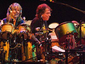 The Dead (band) - Tipper Gore and Mickey Hart playing drums together during The Dead concert in April 2009