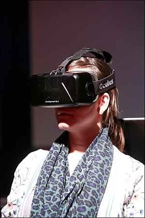 A woman wears Rift Development Kit 2 at Toekomst Festival