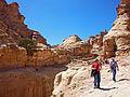 Tourists walking canyon edge near Ad-Dair, Petra.jpg