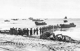 Landing at Aitape - Troops unloading supplies at Aitape