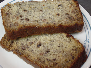 Two slices of banana bread on a plate. Recipez...