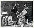 Two unidentified women clean up an alleyway (13562037815).jpg
