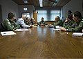 U.S. Air Force Lt. Col. Benjamin Busch, center, the commander of the 52nd Operations Support Squadron, briefs members of the Romanian air force during a familiarization tour at Spangdahlem Air Base, Germany 140326-F-NJ596-011.jpg