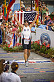 U.S. Navy Lt. Cmdr. Damon Dixon, the executive officer at Naval Oceanography Special Warfare Center in Kailua-Kona, Hawaii, waves the American flag as he crosses the finish line at the 30th Ford Ironman World 081011-N-BV344-003.jpg