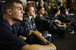 U.S. Navy midshipmen watch a three-on-three basketball tournament in the hangar bay aboard the aircraft carrier USS Nimitz (CVN 68) June 23, 2013, in the Gulf of Oman 130623-N-IB033-103.jpg
