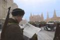 USSR soldier reading 'Pravda' newspaper (34177587083).png
