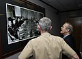 US Navy 031114-N-7293M-043 U.S. Secretary of Defense, Donald Rumsfeld and Rear Adm. Patrick Dunne, Commander, U.S. Naval Forces, Marianas, examine a photo of President Lyndon B. Johnson's Vietnam Summit, held on Guam in 1967.jpg