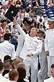 US Navy 040528-N-2383B-178 A newly commissioned Ensign shows off his diploma to the crowd during the U.S. Naval Academy Class of 2004 Graduation and Commissioning Ceremony.jpg
