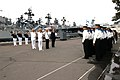 US Navy 040703-N-1693W-010 Commanding Officer of the guided missile cruiser USS Cowpens (CG 63), Capt. John Sorce render honors during an official ceremony during a port visit to Vladivostok, Russia.jpg