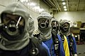 US Navy 040805-N-0499M-001 Personnel assigned to the Air Department, stand by for further instruction during a recent General Quarters (GQ) drill conducted aboard the Nimitz-class aircraft carrier USS Abraham Lincoln (CVN 72).jpg