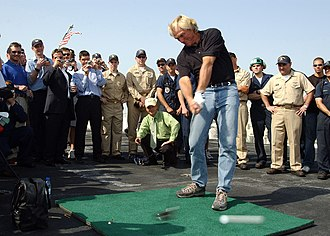 Drive (golf) -  Professional golfer Greg Norman drives a golf ball off the flight deck of USS ''John F. Kennedy'' (CV67)