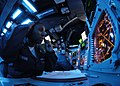 US Navy 041116-N-4748O-149 Operations Specialist 2nd Class Trenesa Perkins, of Landcaster Pa., and Chief Operations Specialist Nick Desoto, of Aurora, Co., monitor aircraft in the combat direction center aboard USS Abraham Linc.jpg