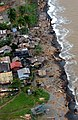 US Navy 041210-M-1188A-011 Logs cover the beach near destroyed homes in Real, Republic of the Philippines after damaging floods.jpg