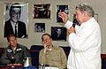 US Navy 050519-N-8148A-003 Commanding Officer, USS Ronald Reagan (CVN 76), Capt. James Symonds, left, and Executive Officer, Capt. William Hart, right, listen as Retired Navy Capt. Walter Wally Schirra speaks.jpg