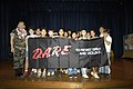 US Navy 050531-N-3207B-046 Master-at-Arms 1st Class Stacey Carfley stands with her recent class of Drug Abuse Resistance Education (D.A.R.E.) program graduates at Pearl Harbor Elementary School.jpg