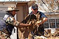 US Navy 050911-N-0793G-006 A U.S. Navy Sailor, assigned to the dock landing ship USS Whidbey Island (LSD 41), and a Mexican Navy Sailor work together to clear debris from a house in a neighborhood in Biloxi, Miss.jpg