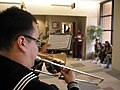 US Navy 051216-N-6430T-023 Musician 3rd Class Ryan Espita, leads the Navy Brass New Orleans on jazzy-rendition of holiday music at Naval Hospital Pensacola.jpg