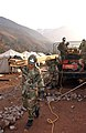 US Navy 060120-F-4462M-002 U.S. Navy Seabees assigned to Naval Mobile Construction Battalion Four (NMCB-4)) build a temporary school in the mountains near Muzaffarabad, Pakistan.jpg