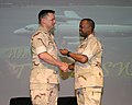 US Navy 060417-N-3207B-065 Cmdr. James Landers receives the Meritorious Service Medal from Commander, Patrol and Reconnaissance Force 5th and 7th Fleet, Rear Adm. Arthur Johnson.jpg