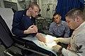 US Navy 060517-N-1745W-059 Airman Jason Schrunk watches Hospital Corpsman 3rd Class Matt Petersen injects anesthetic into Storekeeper 3rd Class Benjamin Alpers' toe.jpg