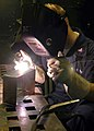 US Navy 060615-N-4325W-006 Aviation Structural Mechanic Airman Jared Marwitz welds a metal box together aboard the Nimitz-class aircraft carrier USS Dwight D. Eisenhower (CVN 69).jpg