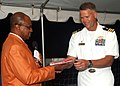 US Navy 061115-N-3285B-197 The commanding officer of the Oliver Hazard Perry-class frigate USS Stephen W. Groves (FFG 29) receives the newly introduced flag of the Caribbean Island of Sint Eustatius.jpg