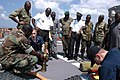 US Navy 070213-N-4657D-004 Sailors attached to the guided-missile frigate USS Kauffman (FFG 59), conduct hands-on damage control training with Gabonese Navy sailors.jpg