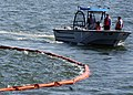 US Navy 070307-N-4049C-021 Sailors assigned to Naval Station Mayport Harbor Operations conduct oil spill containment and recovery training.jpg