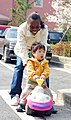 US Navy 070406-N-4124C-058 Seaman Melinda E. Darrell plays with a Korean child from the Jong Duk Won orphanage as part of a community service project sponsored by the amphibious assault ship USS Essex (LHD 2).jpg