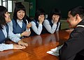 US Navy 070406-N-6710M-023 Operations Specialist 3rd Class Samuel Gomez assigned to the amphibious transport dock ship USS Tortuga (LPD 46), meets with students from Dongjin Girls Middle School in Jinhae City.jpg