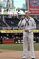 US Navy 070501-N-1635S-001 Standing in front of a crowd of over 19,000 people, Intelligence Specialist 2nd Class Jarrod Fowler from San Bernardino, Calif., sings the national anthem prior to a San Diego Padres game in Petco Par.jpg