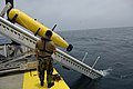 US Navy 070612-N-7676W-102 Chief Aerographer's Mate Trung Freed, from Naval Mine and Anti-Submarine Warfare Command, Corpus Christi, Texas, monitors the deployment of a Bluefin Autonomous Underwater Vehicle (AUV) during a.jpg