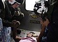 US Navy 070907-N-1189B-206 U.S. Navy aircrewmen comfort an injured Nicaraguan woman prior to take-off during a medical evacuation.jpg