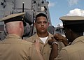 US Navy 070921-N-4649C-082 Chief Personnel Specialist Roberto Manzueta receives his chief petty officer anchors during a pinning ceremony aboard Arleigh Burke-class guided missile destroyer USS Lassen (DDG 82).jpg