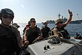 US Navy 070926-N-0841E-035 Team members of the visit, board, search and seizure team assigned to guided-missile frigate USS Carr (FFG 52) prepare to visit to a fishing dhow as part of an interaction patrol.jpg