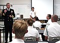US Navy 071016-N-5208T-002 Rear Adm. Gary Jones, commander of Naval Education and Training Command, discusses training opportunities with Cary High School Navy Junior Reserve Officers' Training Corps cadets.jpg