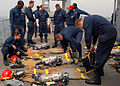 US Navy 080909-N-9134V-009 Sailors prepare to don their fire fighting ensembles during a damage control Olympics aboard the amphibious dock landing ship USS Carter Hall (LSD 50).jpg
