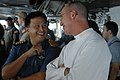 US Navy 081104-N-4005H-329 Rear Adm. Scott Hebner, commander of Carrier Strike Group 7, speaks with a member of the Brunei military during a tour of the bridge aboard the Nimitz-class aircraft carrier USS Ronald Reagan (CVN 76).jpg