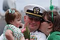 US Navy 090418-N-1308O-030 Lt. Douglas Thompson is greeted by his family during a homecoming celebration for the guided-missile destroyer USS The Sullivans (DDG 68) in Mayport, Fla.jpg