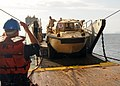 US Navy 090603-N-7631K-063 Boatswain's Mate Seaman Jonathan Bryant signals a Lighter Amphibious Re-supply Cargo Vehicle.jpg